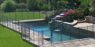 Premier-Pool-Fence-In-Backyard.jpg